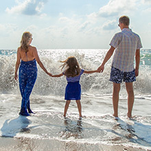 Family Hears Waves on Beach